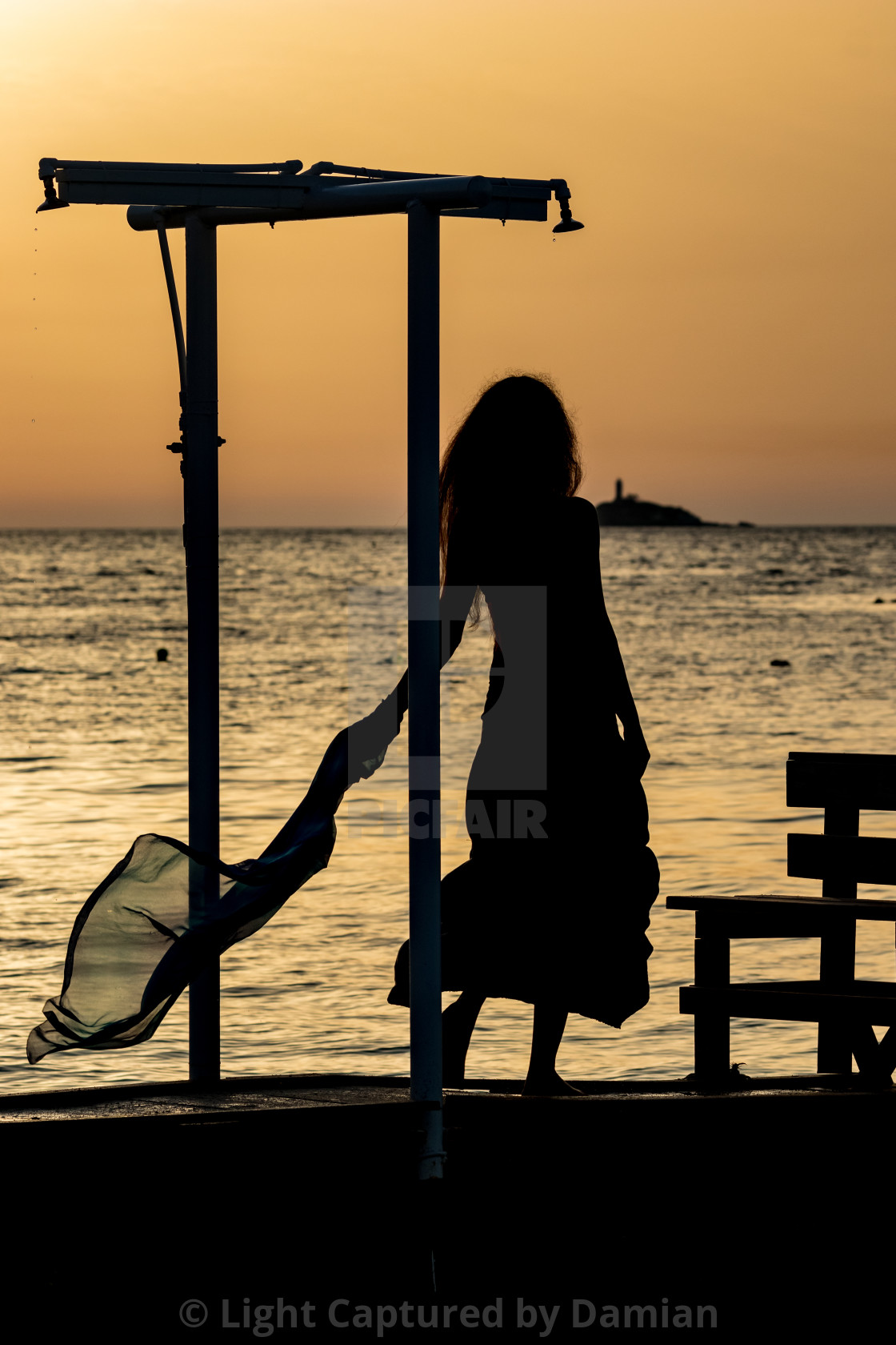 """""""Beautiful silhouette at sunset golden sea water"""" stock image"""
