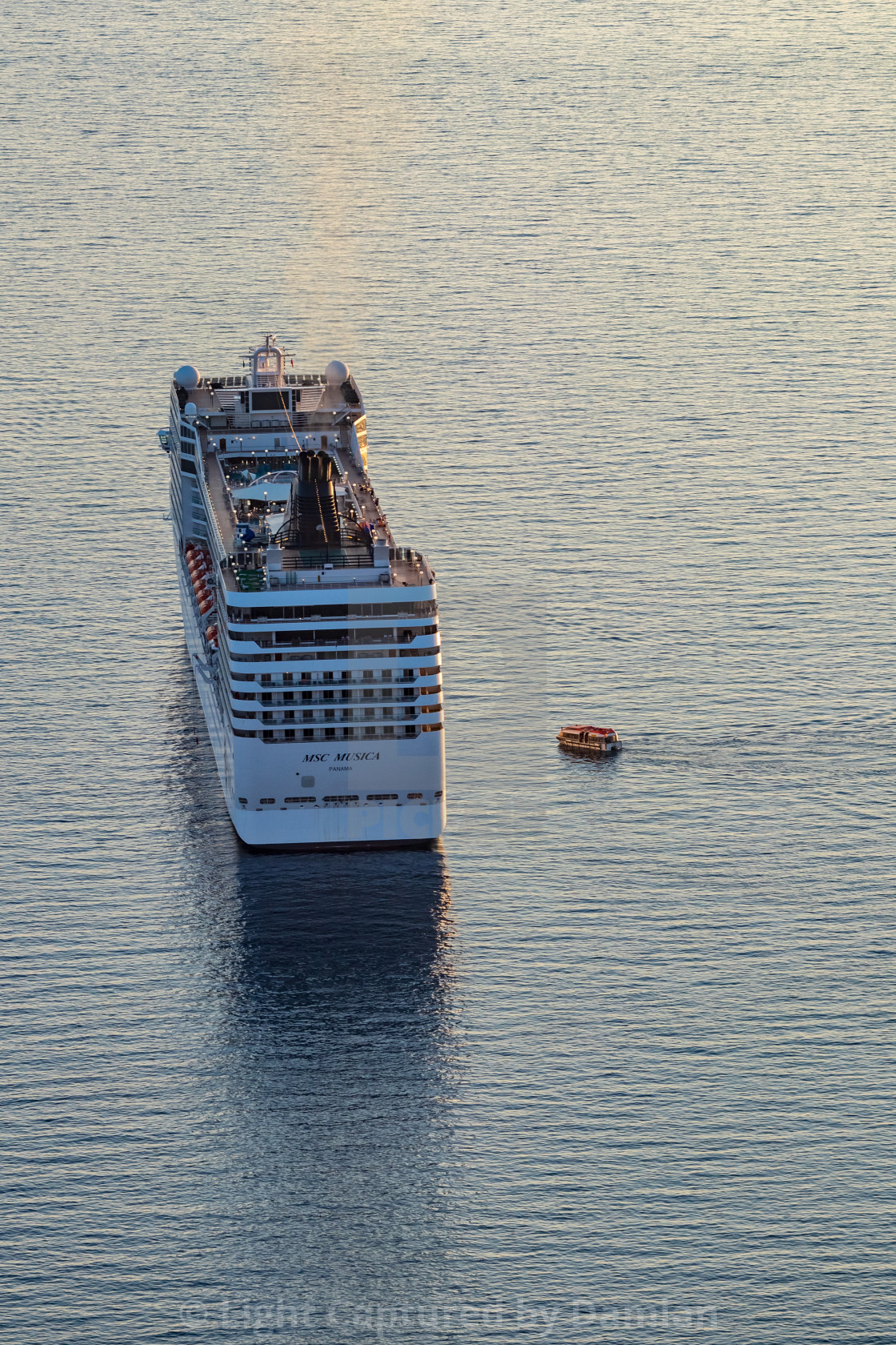 """Cruise ship awaits its passengers,evening,Albania"" stock image"