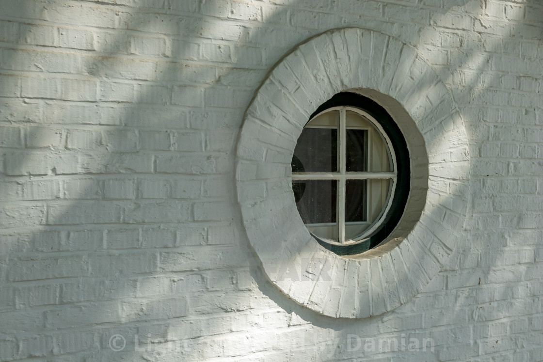 """""""Artistic round window to the street"""" stock image"""