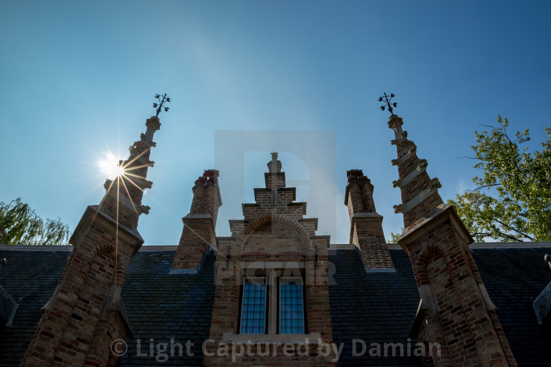 """""""Facade with towers and Sun diffraction"""" stock image"""
