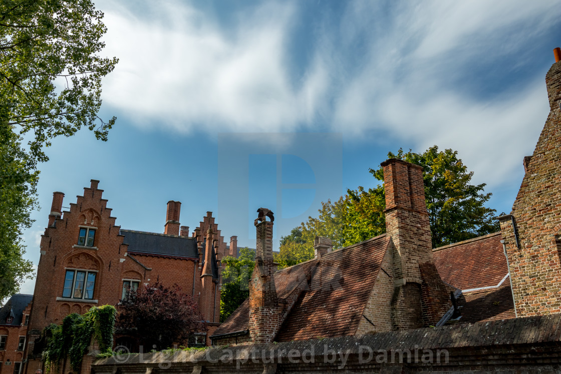 """""""Belgian roofs and street lamp, dynamic clouds"""" stock image"""