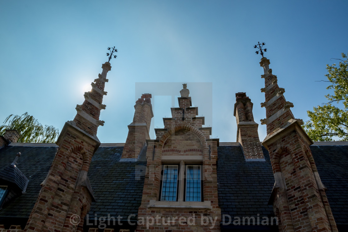 """""""Facade with towers and Sun behind"""" stock image"""