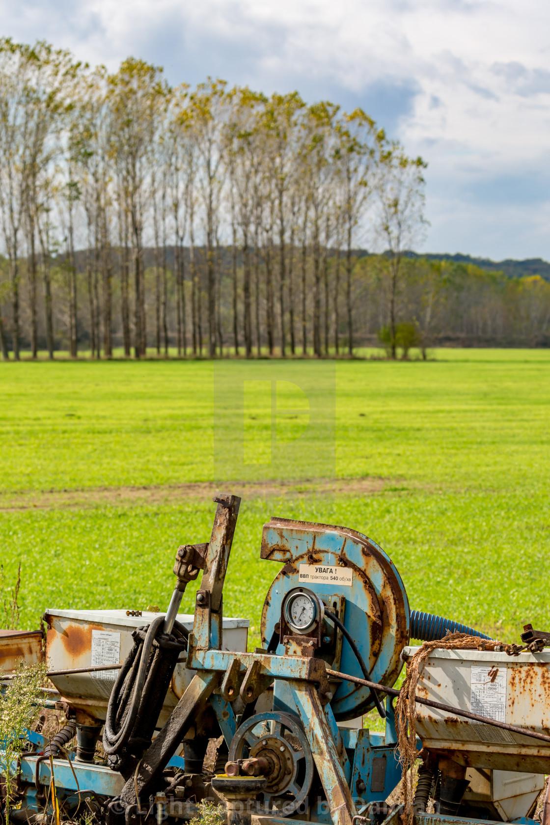 """Old farm machine outdoors"" stock image"