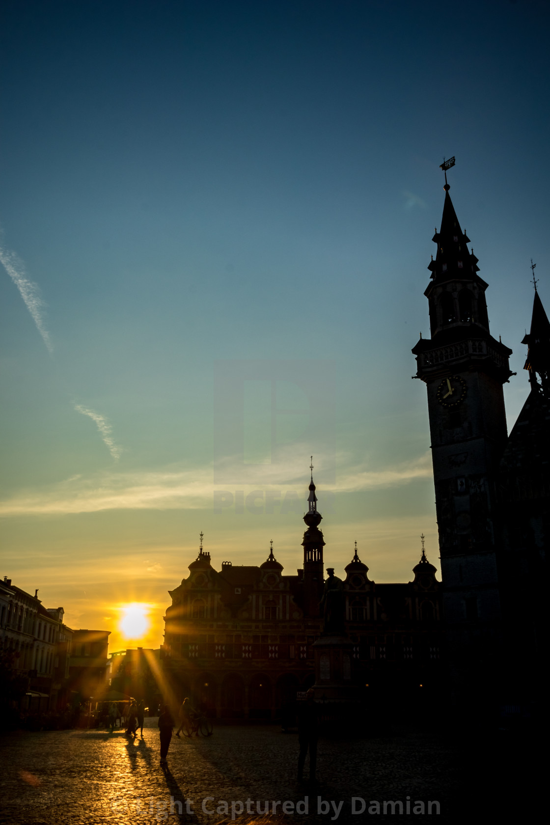 """""""The setting Sun, Aalst main square"""" stock image"""