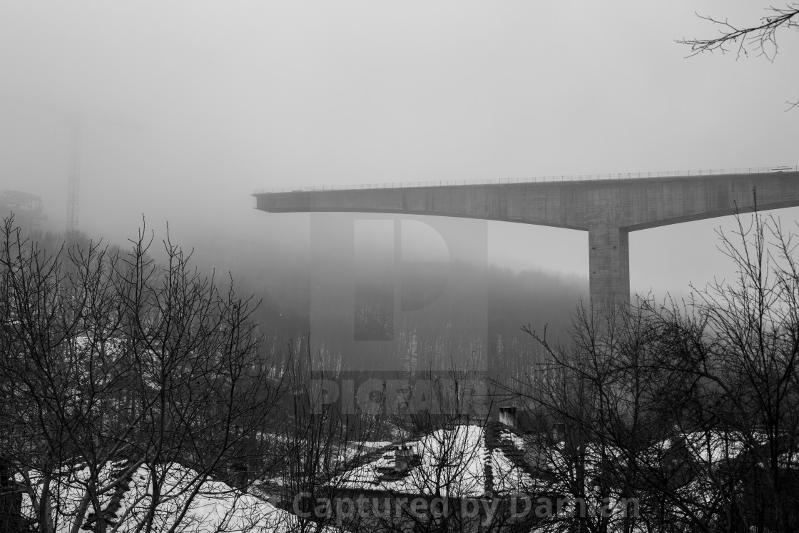 """Thick winter fog and bridge construction"" stock image"