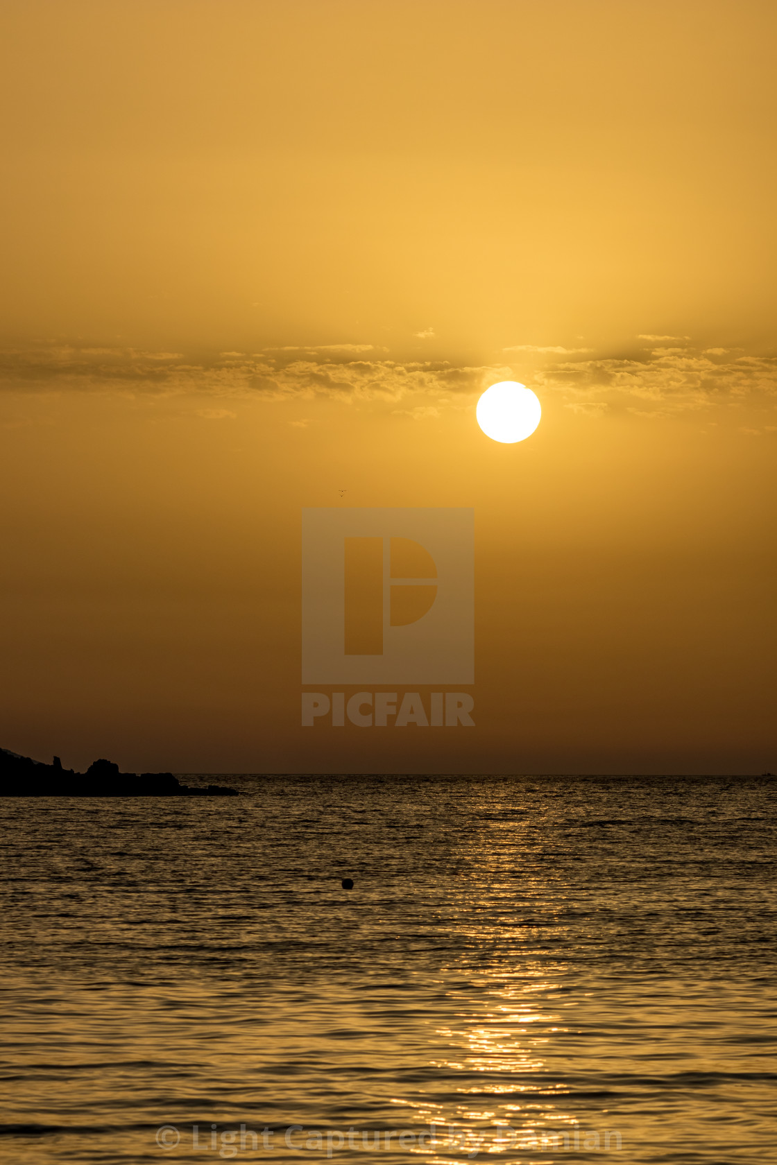 """""""By the beach near sunset golden water, Albania"""" stock image"""