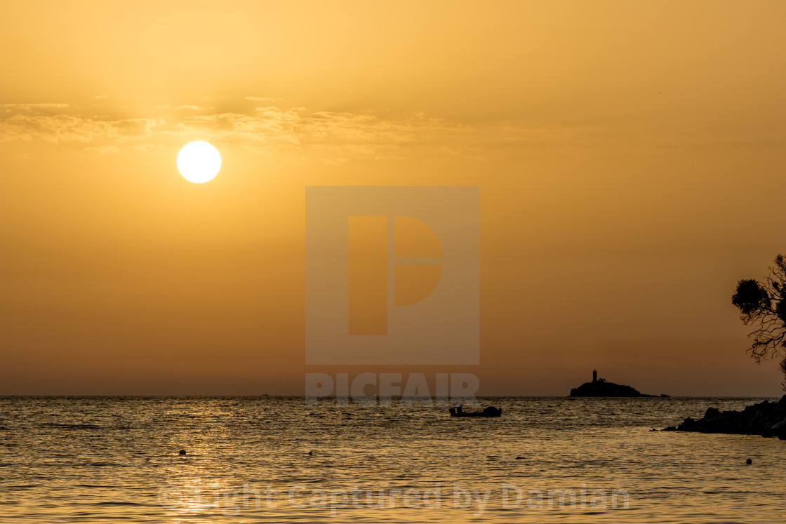 """By the beach near sunset golden water, Albania"" stock image"
