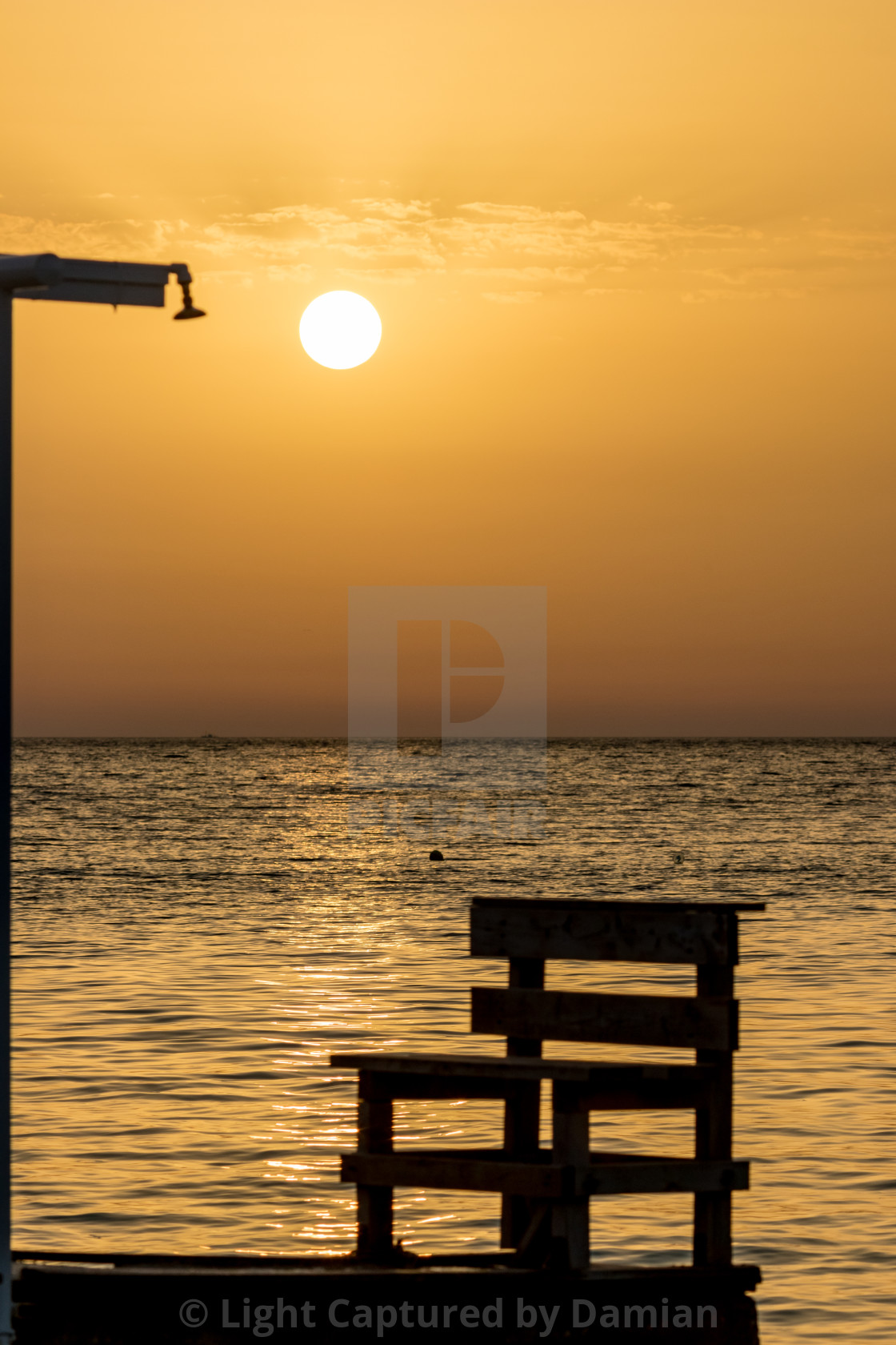 """""""Blurred showers silhouette at sunset golden water"""" stock image"""