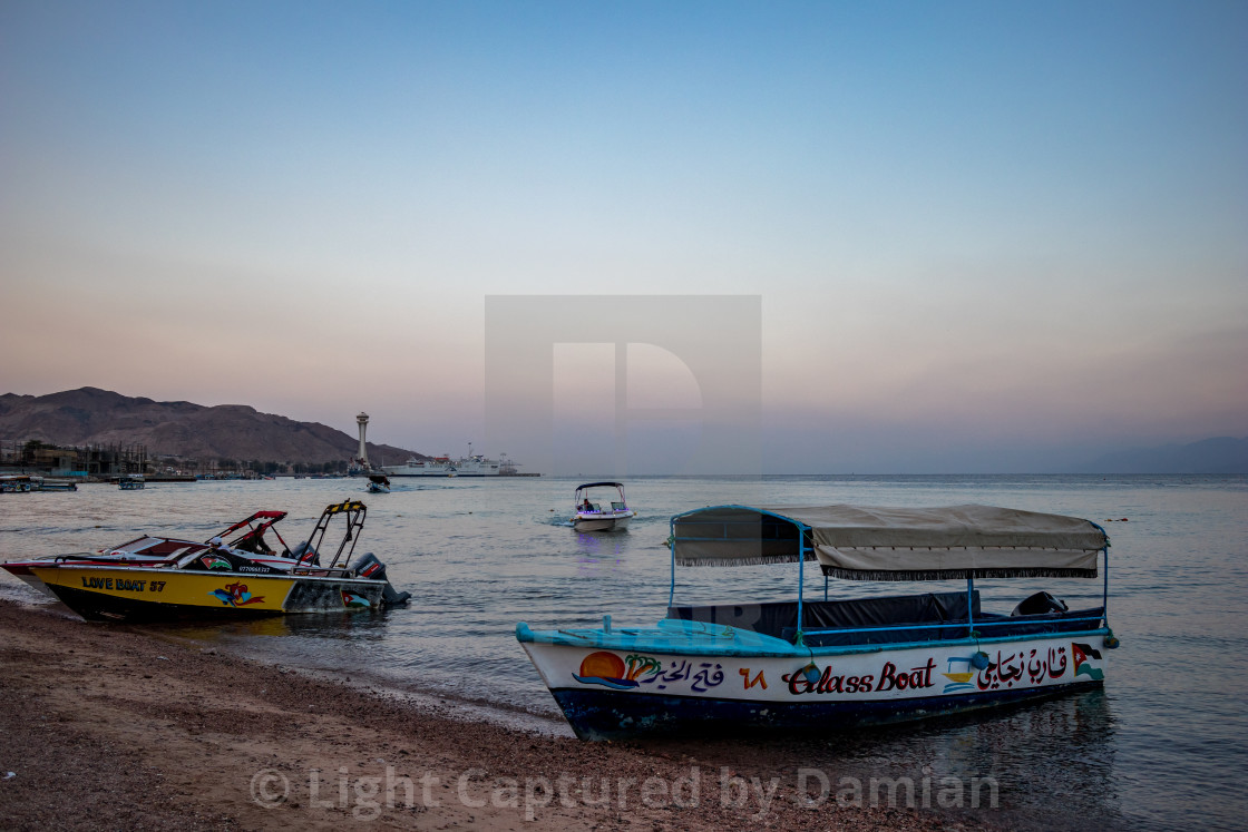 """Glass boats wait for tourists at sunrise, Aqaba"" stock image"