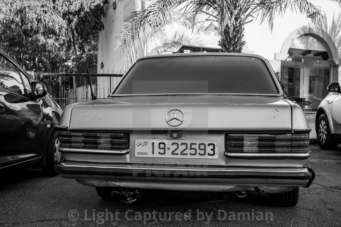"""Retro car with Arabic plate, black and white"" stock image"