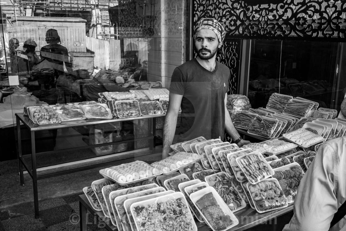 """Young man sells pastries in Aqaba, Jordan"" stock image"