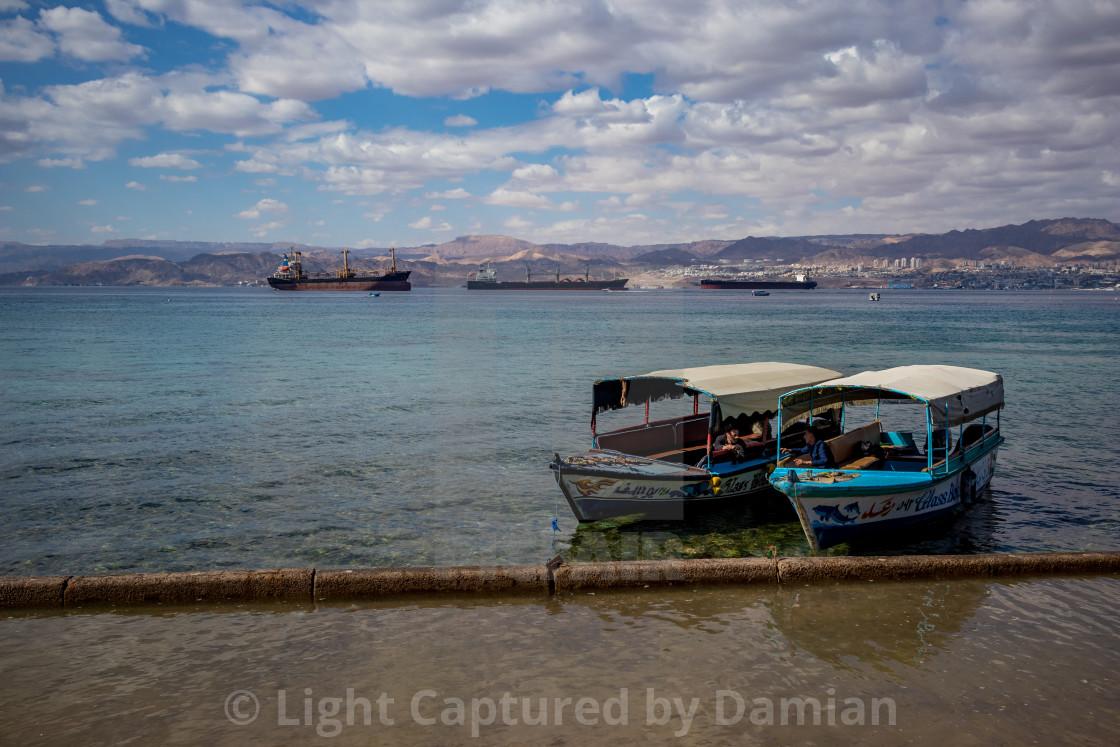 """Jordan, Aqaba, people enjoy holiday at city beach"" stock image"