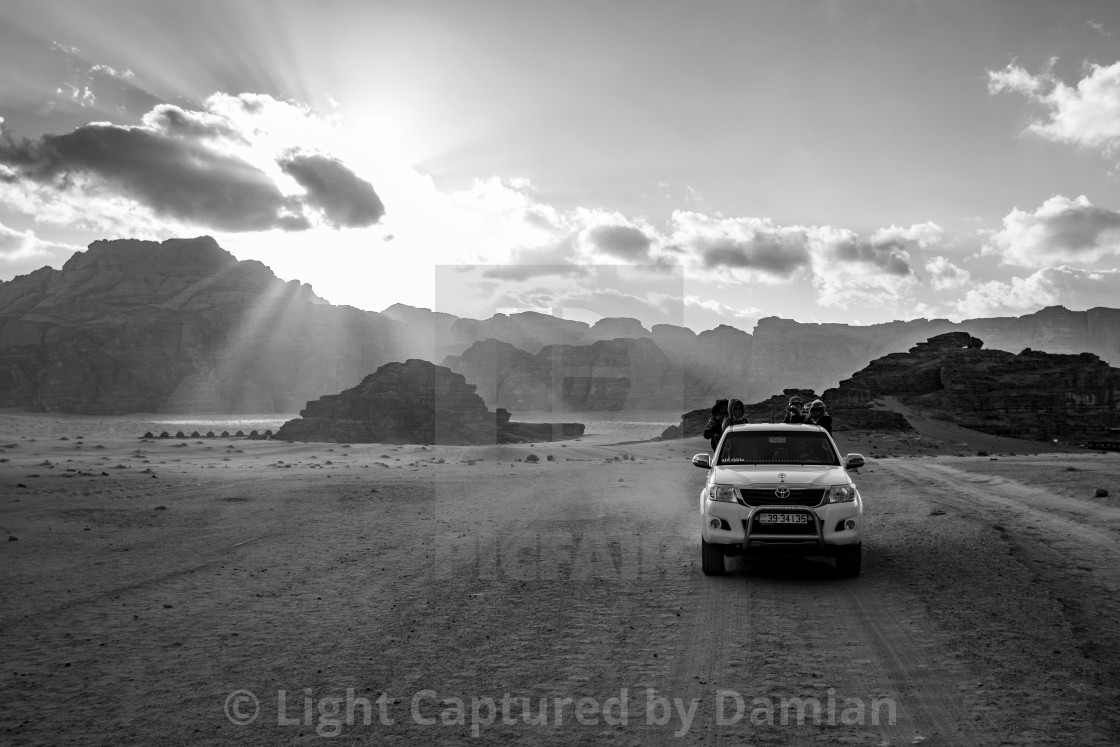 """Jordan, Wadi Rum desert, people and cars on safari"" stock image"