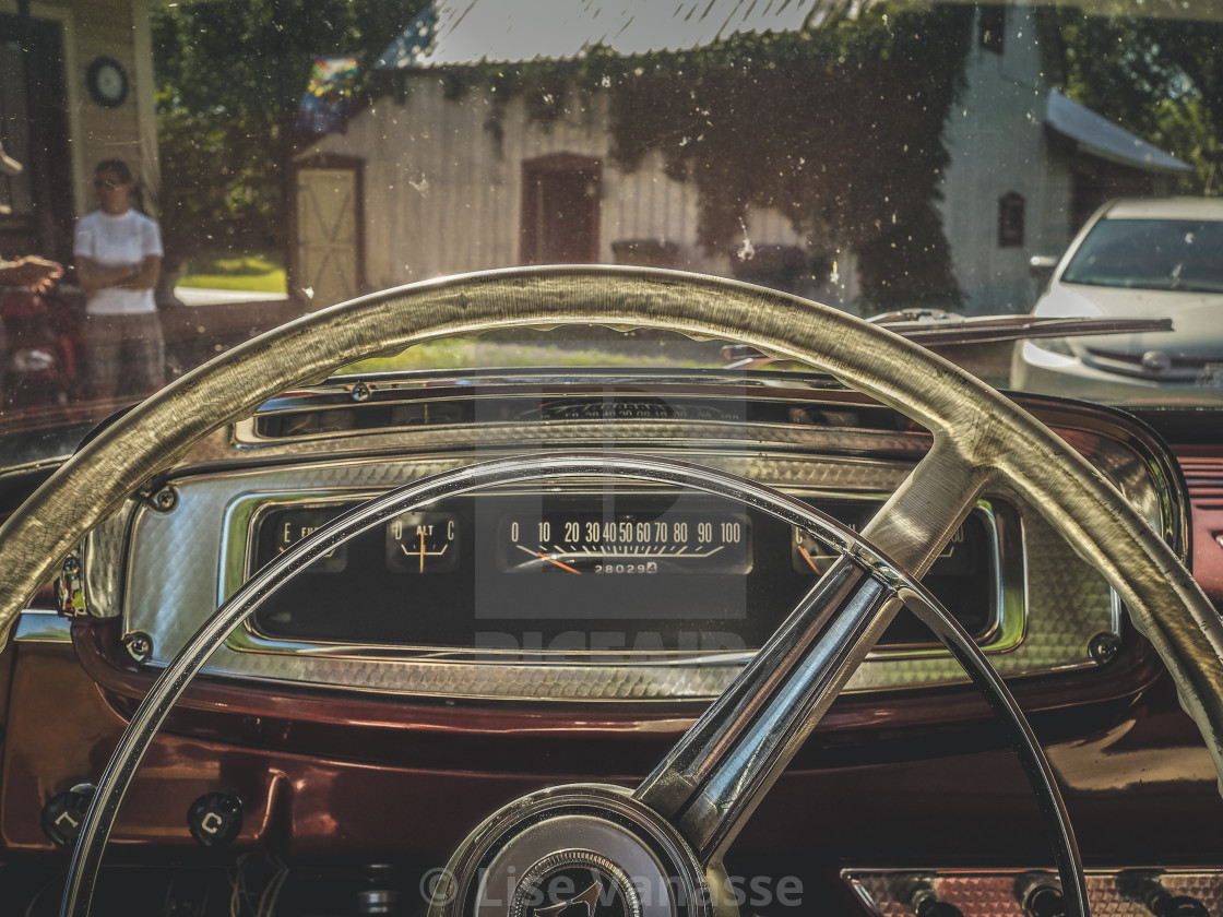 """""""The steering wheel of an old truck."""" stock image"""