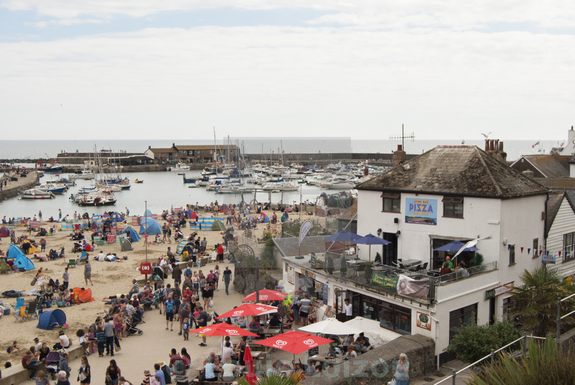 """Busy Lyme Regis beach"" stock image"
