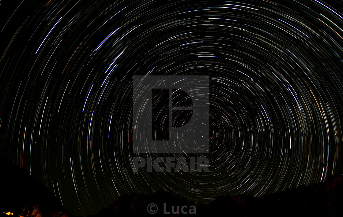 """Noth pole centered startrail with shooting star"" stock image"