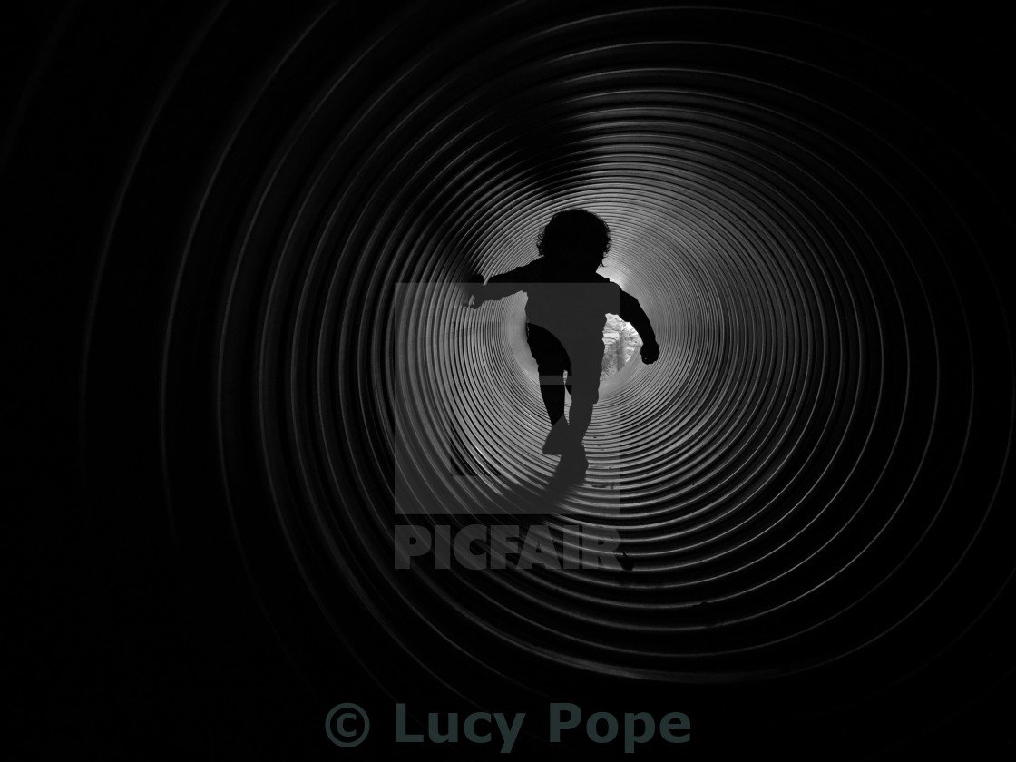 """A boy in a tunnel"" stock image"