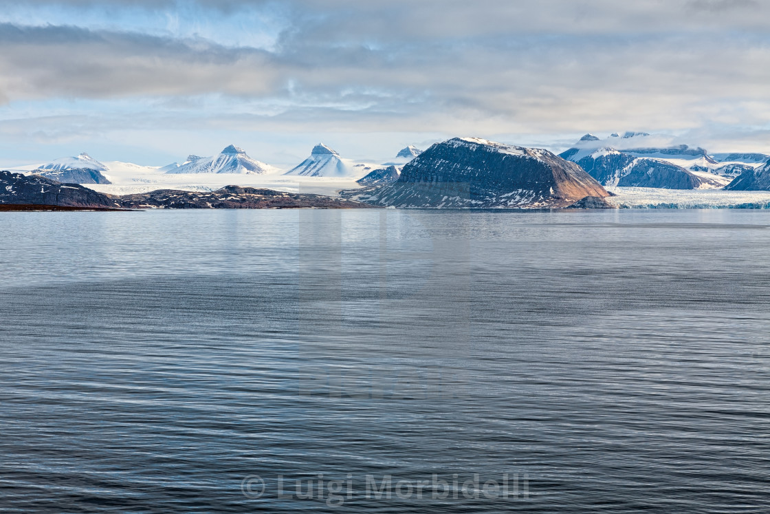 """Mountains and glacier in Svalbard islands"" stock image"