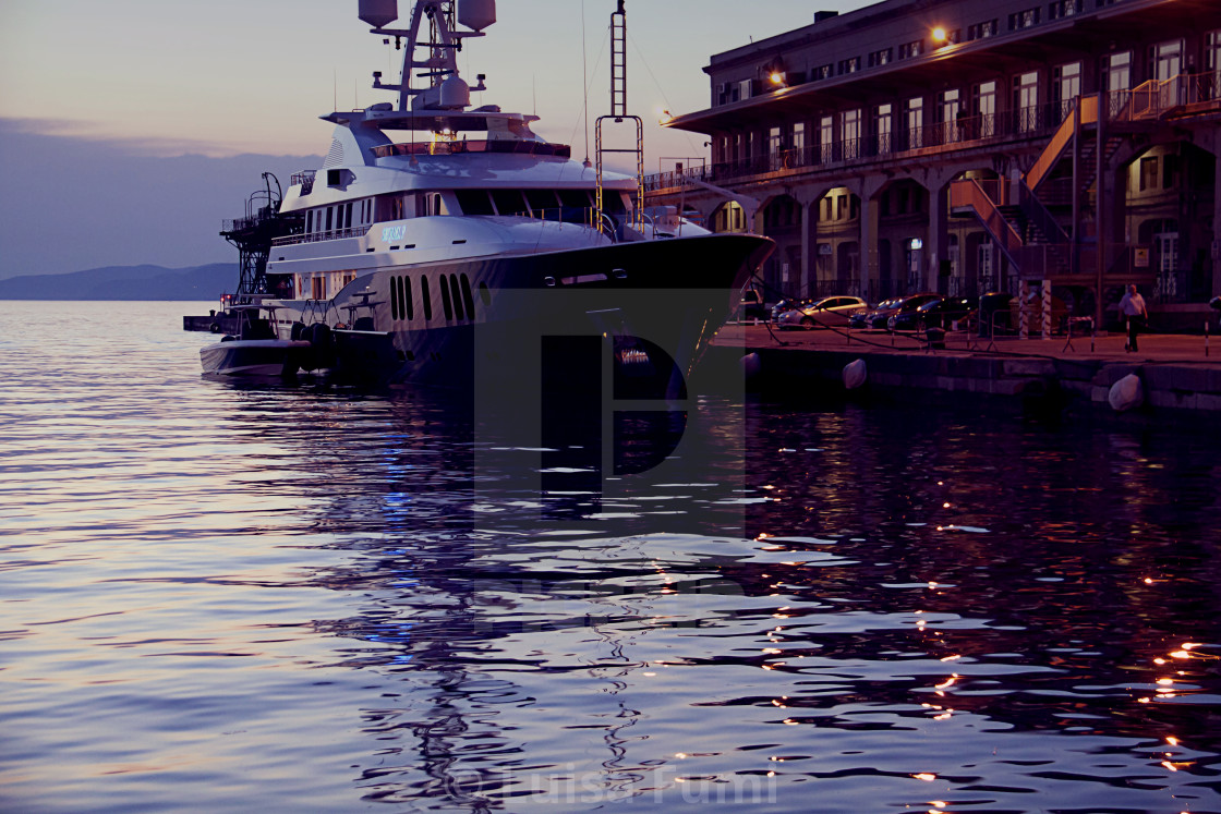 """Yacht moored at Maritime Station in Trieste, Italy at sunset"" stock image"
