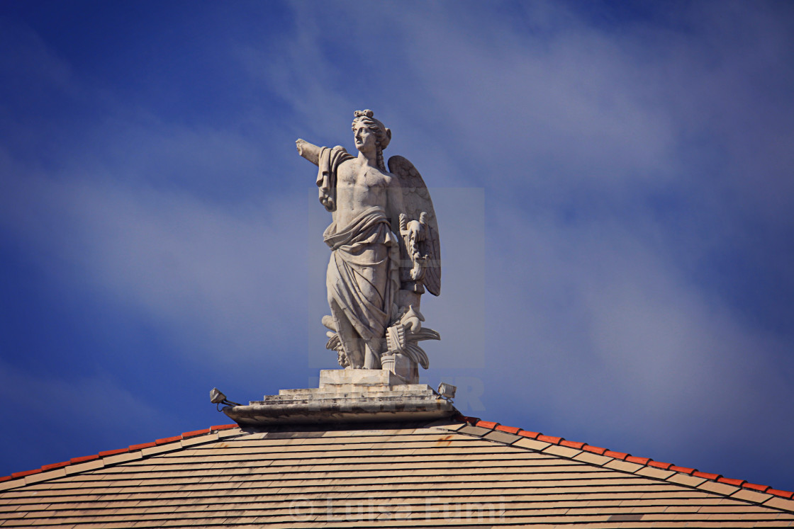 """White antique statue decorating the top of a building in Genoa, Italy"" stock image"