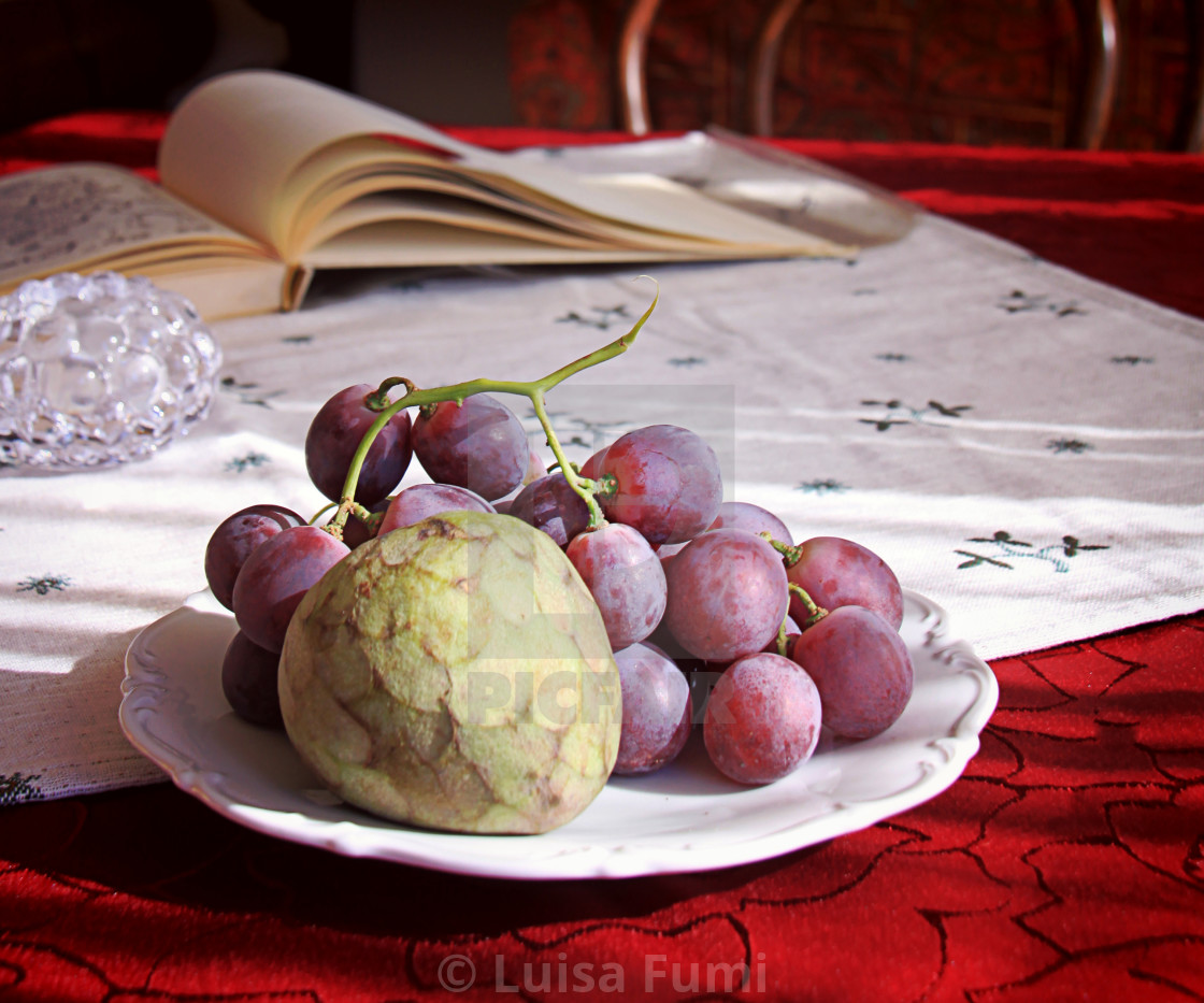 """Autumnal fruits on the table with blurred objects in background"" stock image"