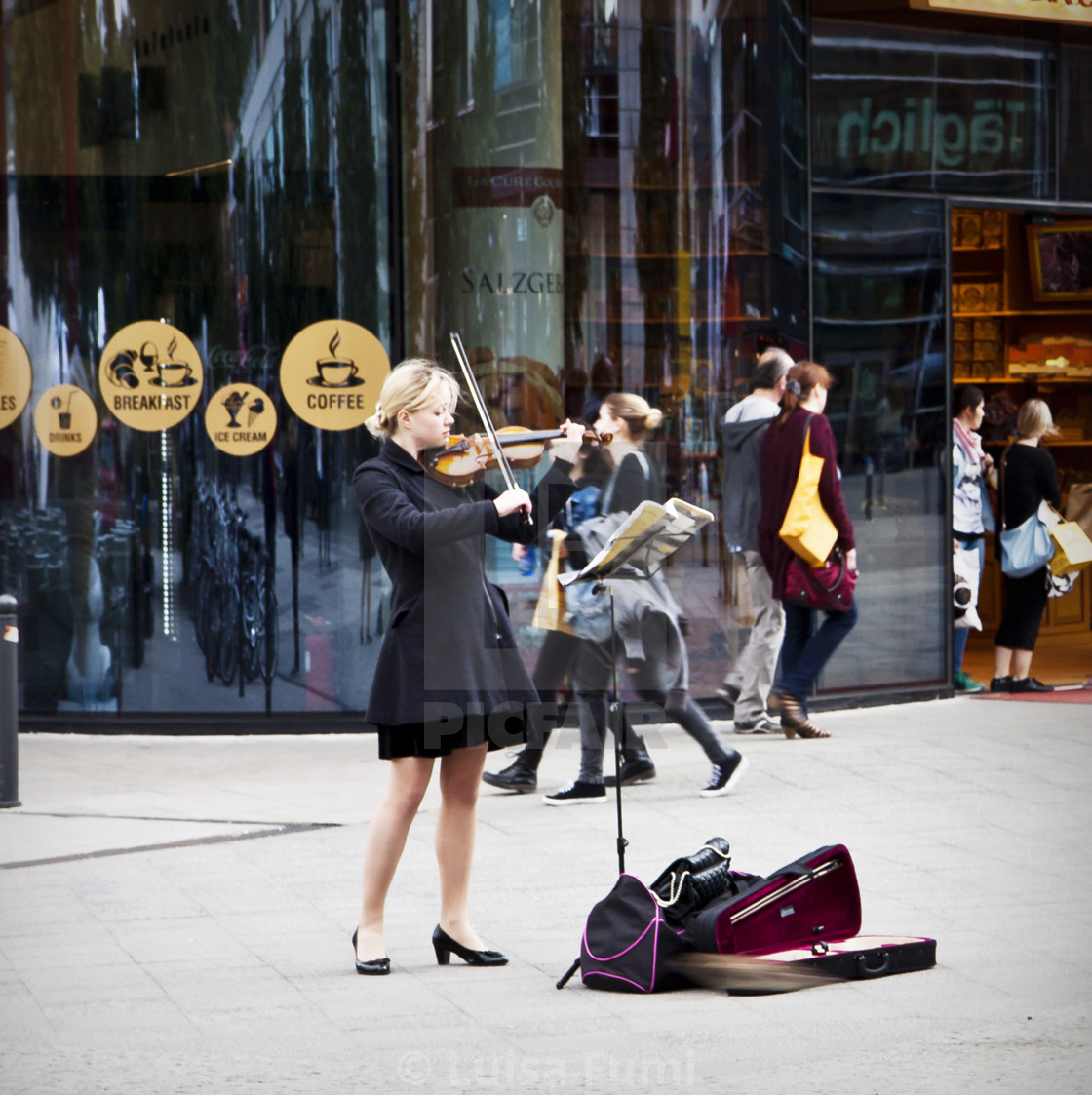 """Street music, young woman performs playing violin in Berlin, city center"" stock image"