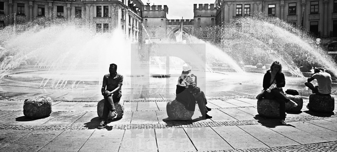 """Summertime, people at the fountain at Karlsplatz-Stachus in Munich"" stock image"