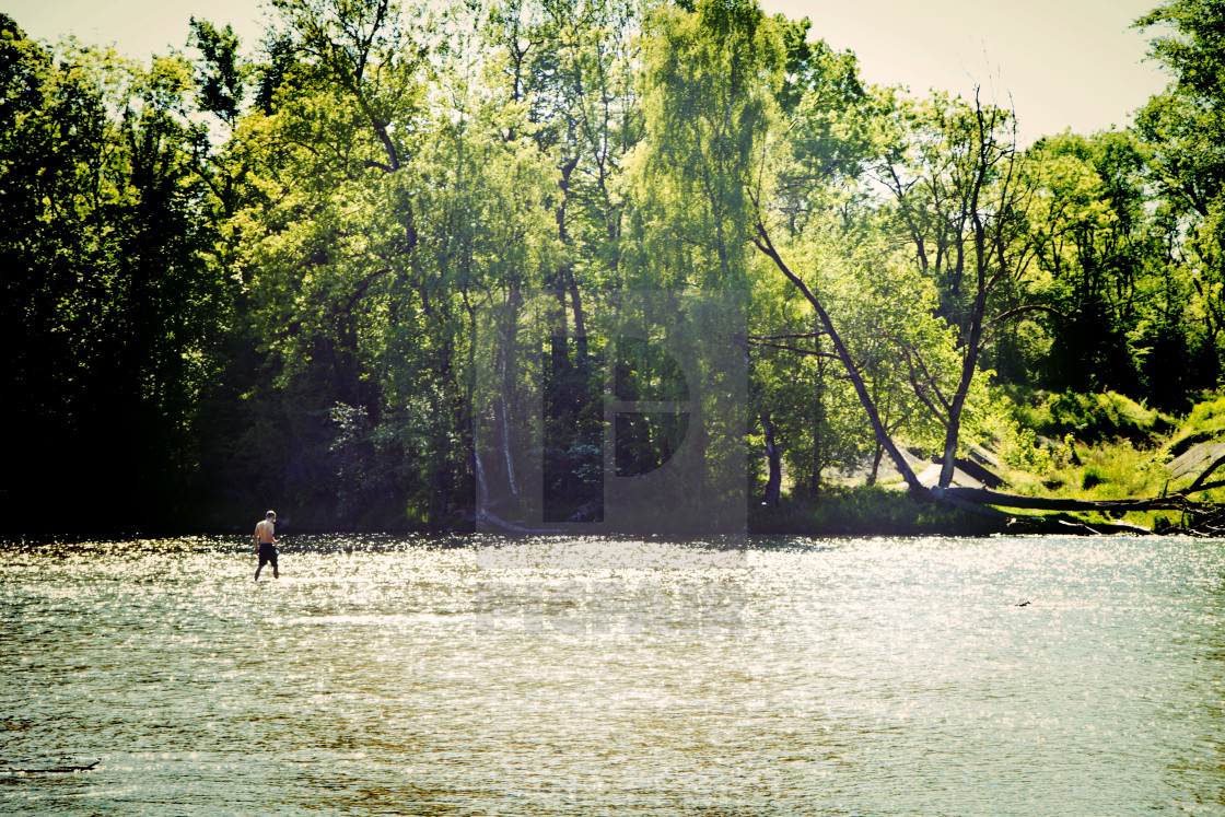 """Germany, Isar river bank, in summer after many sunny days the water level is..."" stock image"