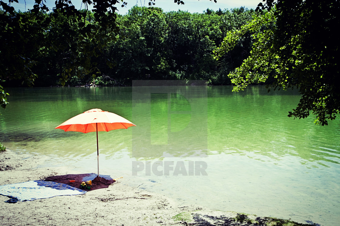 """Orange sunshade for a quiet summer relax on the shore of Poschinger Weiher..."" stock image"