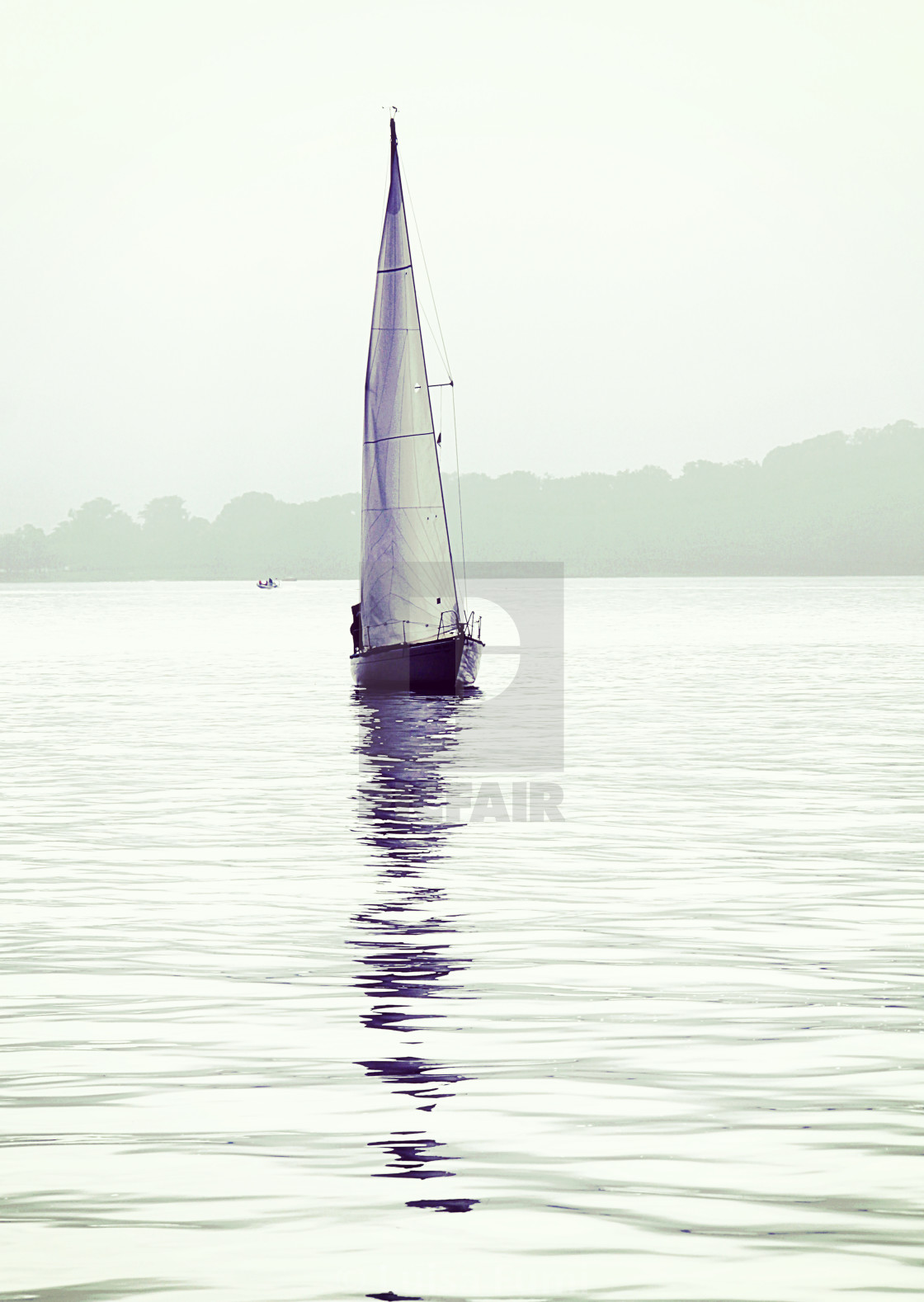 """solitary sailboat with reflection on sea calm waters"" stock image"