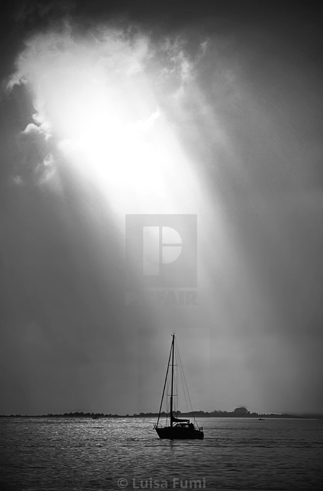 """Quiet after storm, sailboat with sun reflection on calm waters,dramatic..."" stock image"