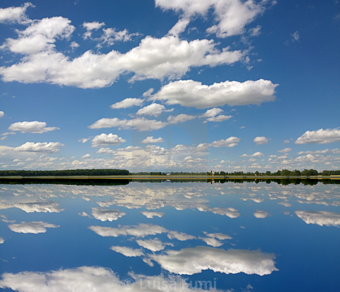 """Sky and cloudscape specular reflection on the calm water surface of a lake,..."" stock image"