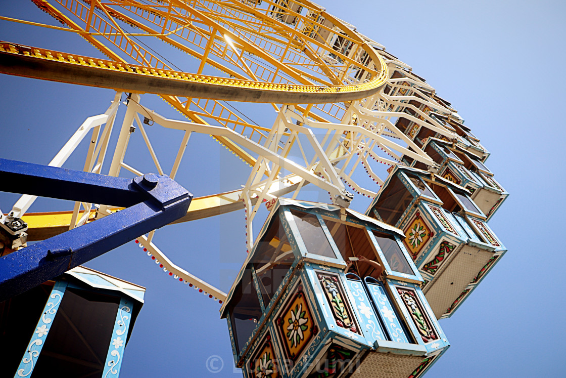 """MUNICH, GERMANY - giant wheel Bavaria style at the Oktoberfest amusement park"" stock image"