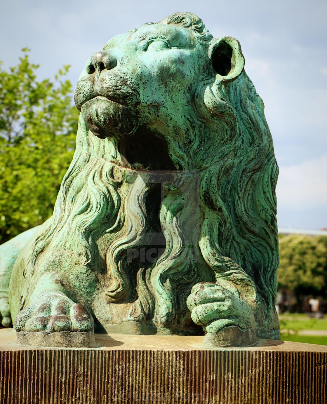 """COPENHAGEN, DENMARK - bronze green lion statue"" stock image"