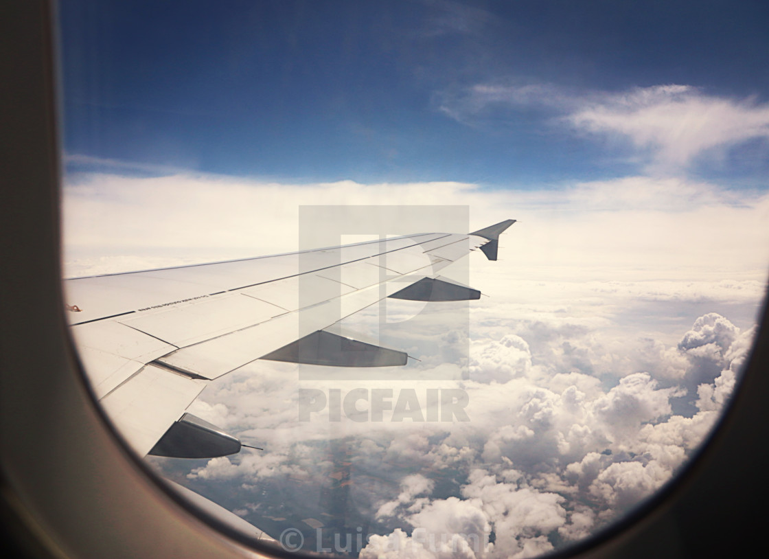 """View from airplane, cumulus of white clouds"" stock image"