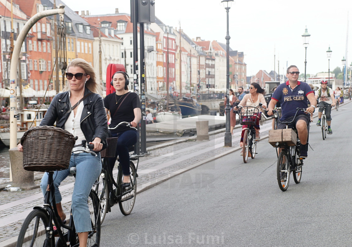 """COPENHAGEN, DENMARK - people on bike"" stock image"