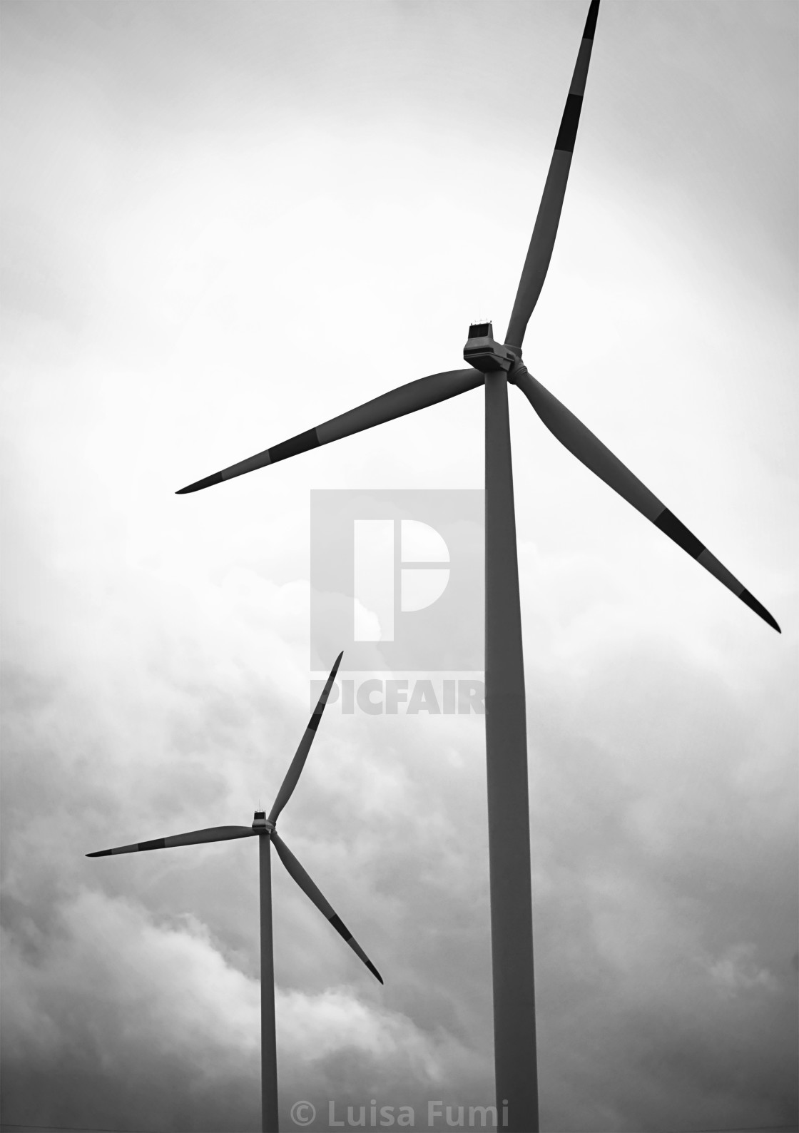 """Windmills against a cloudy sky"" stock image"