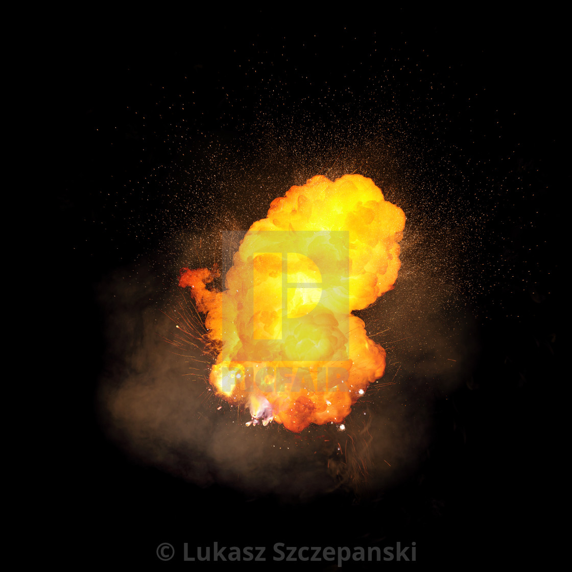 """""""Realistic fiery explosion, orange color with sparks and smoke isolated on black background"""" stock image"""