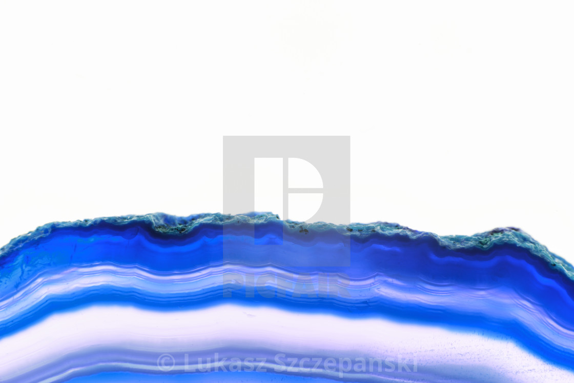 """Abstract background, blue agate striped mineral cross section on white background"" stock image"