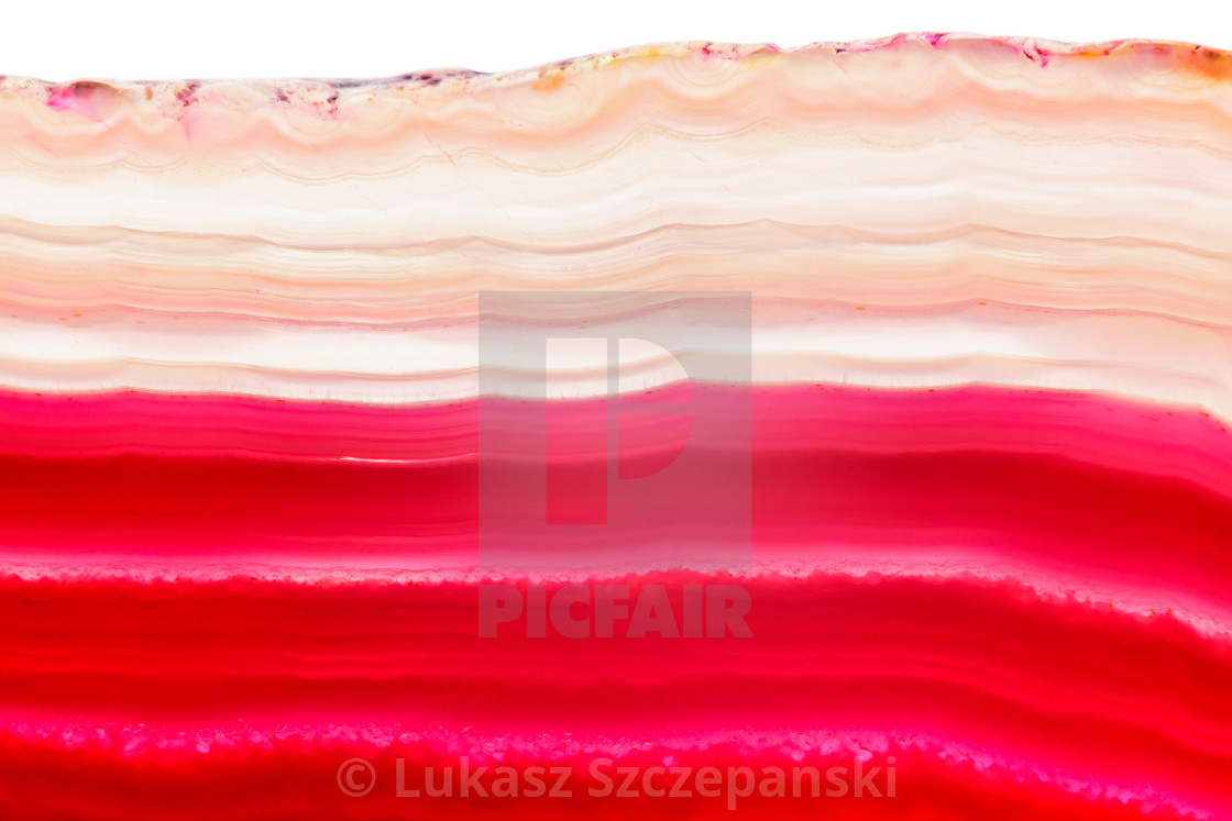 """Abstract background, pink orange and red agate striped mineral cross section isolated on white background"" stock image"