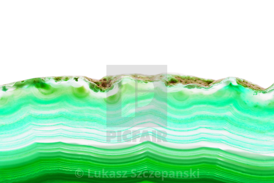 """Abstract background, green lemon striped slice mineral cross section isolated on white background"" stock image"