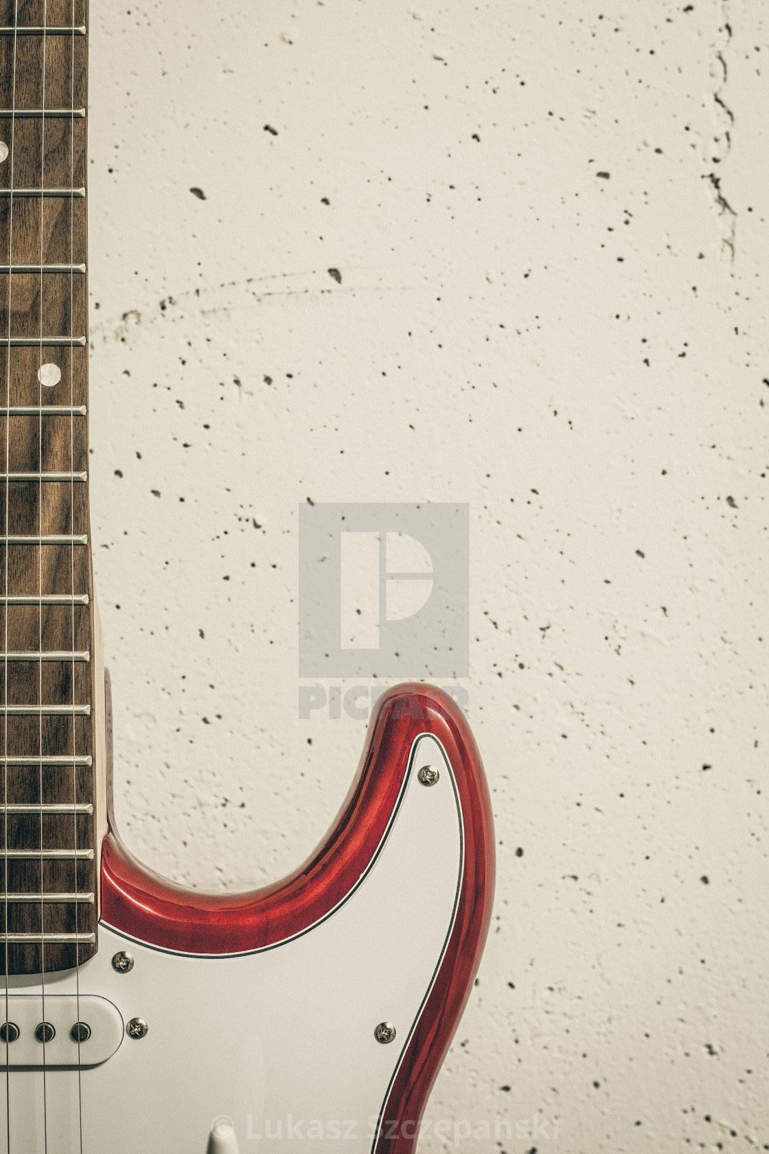 """Red electric close-up against white raw wall, olive toned image"" stock image"