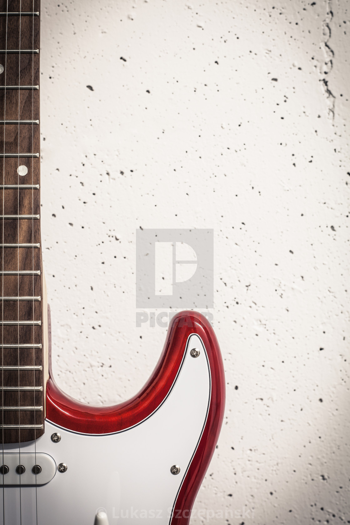 """Red electric close-up against white raw wall, crisp vignette image"" stock image"