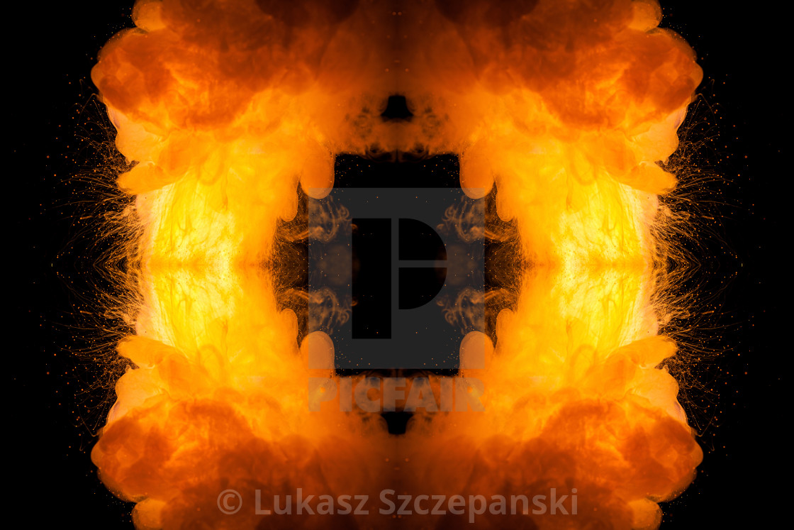 """Realistic fiery explosion on a black background Realistic fiery explosion on a black background"" stock image"