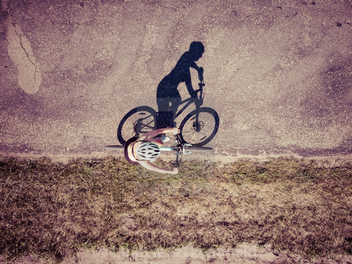 """""""Cyclist on the road, top down image"""" stock image"""