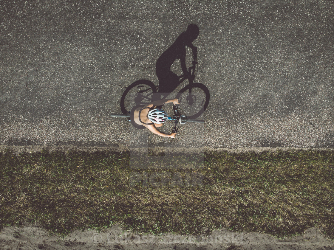 """Cyclist on the road, top down image"" stock image"