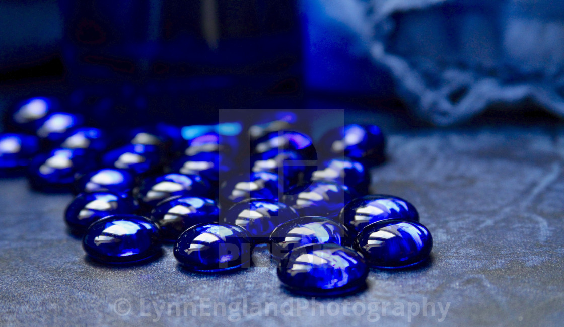"""""""Classic Blue 2020 ....glass beads in natural light from window"""" stock image"""