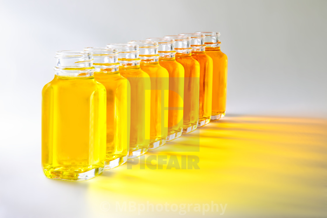 Bottles With Yellow Fluids With Different Shades Of Yellow License Download Or Print For 10 00 Photos Picfair