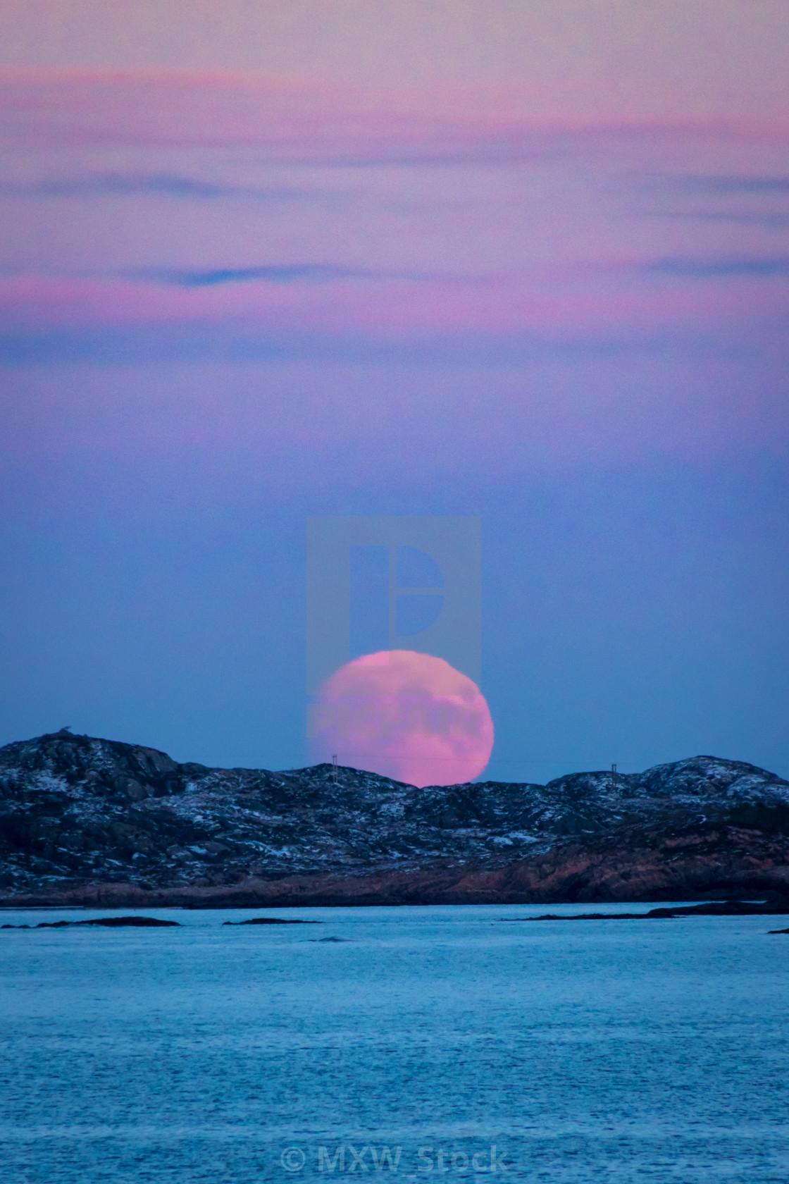 """Moonrise at Skandinavian winter red moon"" stock image"