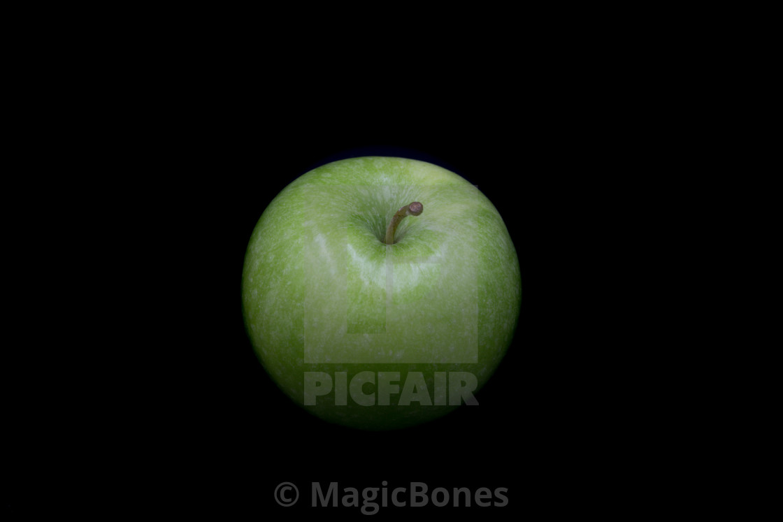 """""""Green Apple on a black background"""" stock image"""